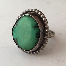 Vintage sterling silver ring with free shape turquoise stone in the c... Lot 849