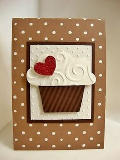 handmade birthday card ... all die cuts ... no stamping ... cupcake with a red heart on top ... like the way she got the swirls of the embossing folder texture to fie into the punch/die ... great card!!