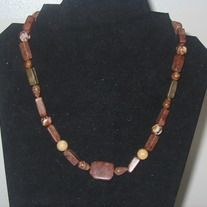 Get back to nature with this semi-precious gemstone necklace made of different types of jasper.  This necklace measures 18 1/2 in long.  There might be stones other than jasper, I'm not really sure, but each bead is a semi-precious gemstone.