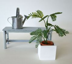 PLANT_1/6 SCALE_FOR 10 TO 12 DOLLS. A beautiful natural looking dollhouse miniature plant. Designed and handmade by: Fashion Doll Store Tiny Red Button  This Listing is for 1 plant in a terracotta pot and 1 planter. Every plant looks slightly different. NOTES: - Our items are intended for adult collectors. - Protected trademarks: Dolls on the photos and doll brand names are used to demonstrate the scale size only. Protected art shown on photos is not for sale, only used to show the picture…