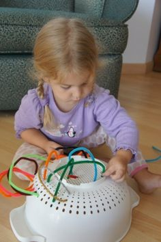 pipe cleaners and a colander to keep them busy by iris
