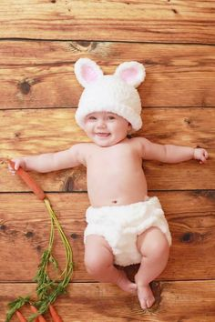 baby w/ bunny ears holding a carrot easter picture ideas
