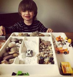 Use drawer organizers for construction sensory play. Avoid the smaller stones for children who still mouth items - Image from Today's Parent Magazine Sensory Tubs, Sensory Activities, Sensory Play, Preschool Activities, Preschool Centers, Todays Parent, Small World Play, Indoor Play, Toddler Fun