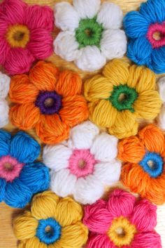 Puff Stitch Flowers crocheted- no pattern, but I bet I could figure out how to make them...