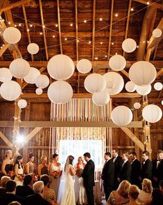 indoor barn wedding decor ideas with paper lanterns and string lights for a winter wedding or celebration White Paper Lanterns, Rustic Lanterns, Wedding Paper Lanterns, Indoor Lanterns, Cheap Lanterns, Chinese Lanterns Wedding, Hanging Paper Lanterns, Paper Lantern Decorations, Barn Party Decorations