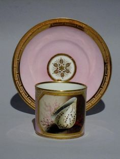 A rare BARR, FLIGHT & BARR Worcester pink ground coffee can & saucer, circa 1813. Impressed crowned monogram mark and full red script (saucer) Probably painted by THOMAS BAXTER.. The can finely painted with panels of sea shells, coral and sea grasses, reserved upon a pink ground within a gilt Grecian border, the saucer with matching border & ground and with a central gilt star motif. From the service ordered by R. Cosway Esq.,from Joseph Flight & Martin Barr