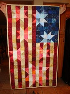American Flag Quilt/ Wall hanging. $40.00, via Etsy. Would love to have a full size version for a guest room bed!