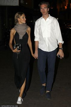 The apple of her eye: Delevingne ditched her green gown for a midnight blue maxi dress and...