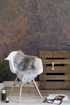 Industrial decor with an elegant twist. This metal effect wallpaper design is completely unique, bringing deep midnight blue tones mixed with copper into your home. Keep the decor minimal to compliment the look.