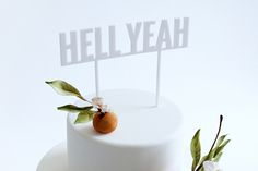 Here's the cake topper to add some enthusiasm to three-tiered, flower-frosted dessert—because HELL YEAH, you're getting married.