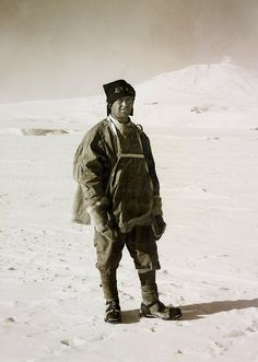 Herbert Ponting  Captain Scott  February 1911  © 2011 Her Majesty Queen Elizabeth II    .  This photograph of Scott, with Mount Erebus in the background, was taken at the start of the expedition. He is wearing fur gloves with an attached cord, leather boots, gaiters and thick socks