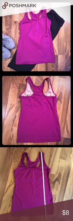"Purple Motion Wear Running Sport Tank sz M Purple Motion Wear Running/Swim/Sport top. Women's Medium Is lined in the bust era and has a ""built in"" bra. Pre-owned. Light wear overall. No pilling. Material: Nylon, Spandex Care: Machine wash & dry Measurements: Length 22.75"" see pictures for other measurements I do my best to ship same or next day! Bundle to save! Motion Wear Tops Tank Tops"