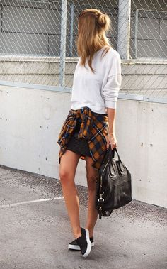 White sweater + black mini skirt + black flats + orange and blue check shirt