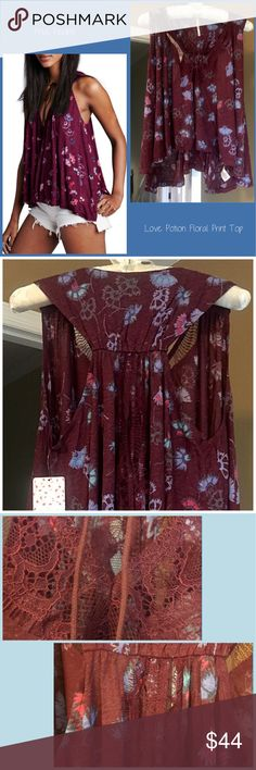 Free People Love Potion Floral Print Top Free People Love Potion top with pretty Floral all over Print and high-low cut. Trimmed in delicate sheer lace. V-neck. Lace also runs down split racerback. Swingy soft comfortable top! Free People Tops Tank Tops