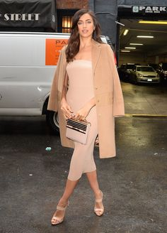 Irina Shayk wearing a Vionnet dress and Giuseppe Zanotti heels.