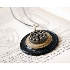 Vintage Button Necklace, Art Deco Pendant, Black Beige Celluloid... ($28) ❤ liked on Polyvore featuring jewelry, necklaces, pendant necklace, silver flower pendant, vintage pendants, silver flower necklace and vintage silver necklace