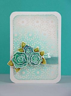 luv the strong colors of the roses and the subtle coloring of the embossed background  layer...