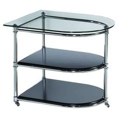 """End table with a chrome-plated base and caster feet. Features a glass top and 2 shelves.   Product: End tableConstruction Material: Chrome and glassColor: Chrome and blackFeatures:  Castered feetTwo shelves Dimensions: 24"""" H x 28"""" W x 24"""" D"""