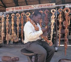 Rainos Tawonameso with original Nyaminyami walking sticks in Kariba #VisitZimbabwe