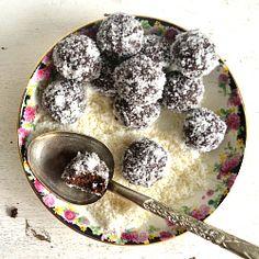 Raw Vegan Chocolate Power Balls rolled in Coconut. Enjoy!
