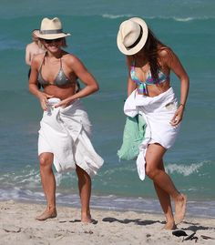 Julianne Hough and Nina Dobrev Break Out Their Bikinis For a Miami Girls' Getaway: Julianne Hough wore a pink and black bikini.  : Nina Dobrev and Julianne Hough got in the water together in Miami.   : Nina Dobrev soaked up the sun in Miami.   : Julianne Hough and Nina Dobrev walked in the sand on the beach in Miami on 4/26/13.