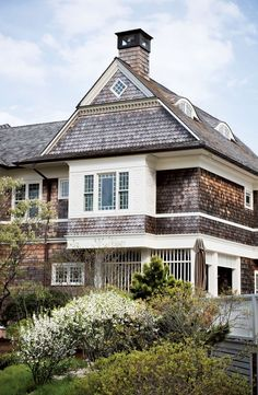 LOVE the scalloped cedar shingles and the curved 3rd floor windows.