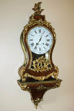 """Fine, French, Louis XV period cartel clock: In working order with rosewood veneers and original gilt bronze mounts.  Signed """"Le Bel Paris.""""  Circa 1750."""