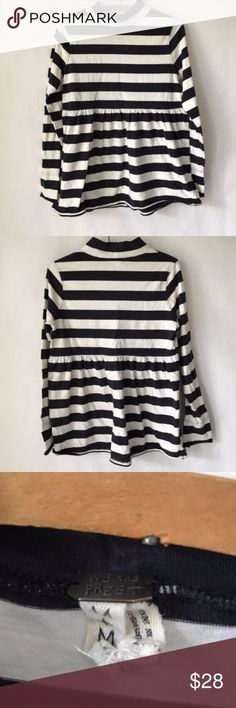 Free People We the Free peplum top size medium Free people fall peplum style top size Medium. Great condition. Navy blue and cream striped. Free People Tops Blouses