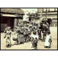 A photo of kids carrying a shrine from T. Enami's collection of Japan life during the late 19th century ...