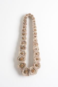 I could crochet a mixture of different size daisies and make missy a necklace somewhat like this