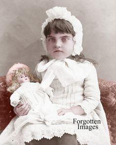 Little girl holding her doll. 1880s.