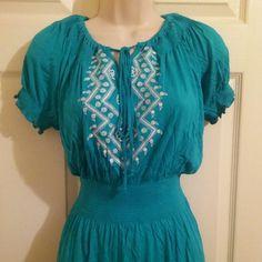 Blue dress with tight waist band White design on chest. Adjustable neckline Dresses