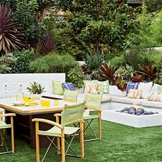 Colorful throw pillows, no-fuss furniture, and a cozy firepit make this an invite place to play. Coastalliving.com