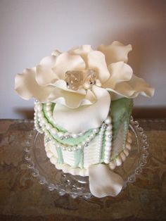 Jewels of the Sea Cake.. Sweet Buttercream covered in Mint Green Ganache, then Draped with Strands of Pearls, A large Flower Tops it Off!!