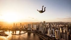 View top-quality stock photos of Man Paragliding In Midair In City At Sunset. Find premium, high-resolution stock photography at Getty Images. Panama, Moving Clouds, Excursion, Dmc, Paragliding, Skydiving, Man Photo, Royalty Free Images, New York Skyline