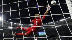 England goalkeeper Joe #Hart watches Daniele #DeRossi's swerving effort strike a post