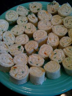 Taco Rollups: 2 pkg cream cheese (1/3 less fat), 1/2 cup finely shredded Mexican 4 or Monterey Jack cheese, 1/4 cup chopped green onion, 1/2 pkg Hidden Valley Fiesta Ranch Seasoning (in the salad dressing aisle). Mix all together and spread evenly onto a medium sized tortilla or wrap. Then roll it up tightly and slowly, so it doesn't tear. Chill the roll-ups for 10-20 minutes uncovered. Slice the chilled roll-ups into one inch slices. | Mad Momma