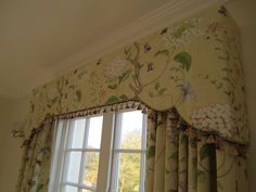 Shaped upholstered pelmet . Piped and trimmed