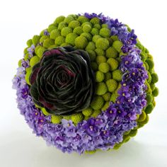 Bouquet Billy Buttons Craspedia globosa and Saint paulia flowers and leaves