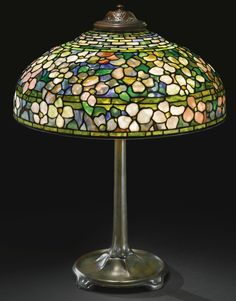 "TIFFANY STUDIOS ""DOGWOOD"" TABLE LAMP (leaded glass and patinated bronze, c. 1910)"