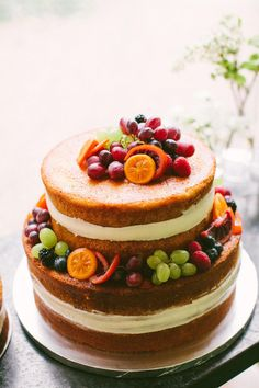Naked cake, summertime wedding, assorted fruits, grapes and berries // Birds of a Feather