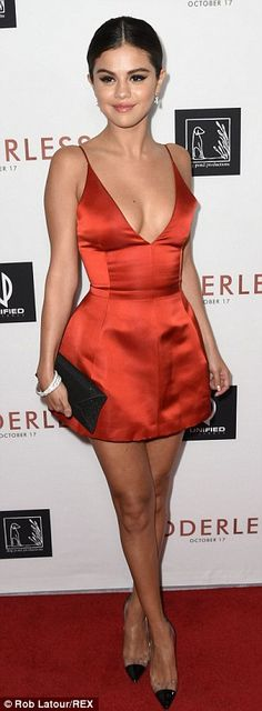 Selena Gomez donned a plunging Dior red dress to the Los Angeles premiere of Rudderless