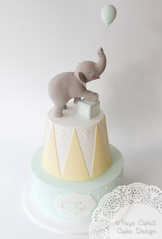 Faye Cahill Cake Design - Two tier child's birthday cake with baby elephant topper