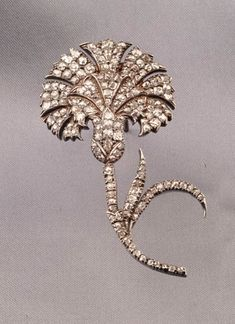 Antique Diamond Brooch, bead-set with old mine-cut diamonds, approx. total wt. 4.375 cts., silver-topped gold mount, lg. 2 7/8 in. Victorian or Victorian style.