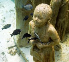 Another underwater sculpture by Jason de Caires Taylor. Created for use as a growth media for coral.