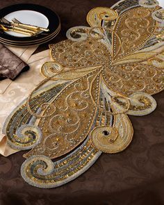 Art Nouveau Table Runner by Kim Seybert at Neiman Marcus. This would look beautiful under a piece of glass for a coffee or side table.