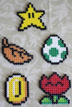 11 Mario Mix Up Perler Bead Magnets/Ornaments (Entire Set as Listed). $12.00, via Etsy.