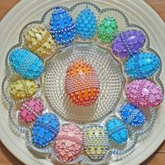 Beaded eggs. Would be cool to paint these on wooden eggs!