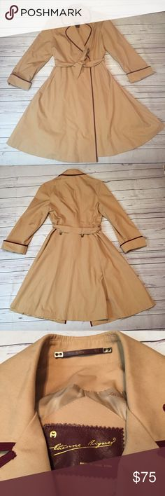 Vintage Etienne Aigner Classic Tan Trench Coat Absolutely beautiful! Very classic and classy look. Interior can be tied to close. Has one interior pocket. The interior is in excellent condition. Has no rips or tears. The Aigner pieces on the back are a bit tarnished but still look great. Only has two marks that I can find but are barely noticeable and I have not tried to remove. The coat measures approx. 45 inches from the top of the shoulder to the bottom. Etienne Aigner Jackets & Coats…