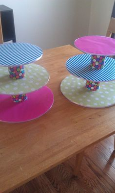 Cupcake stands using cake circles, wrapping paper, duct tape, soup cans and ribbon!